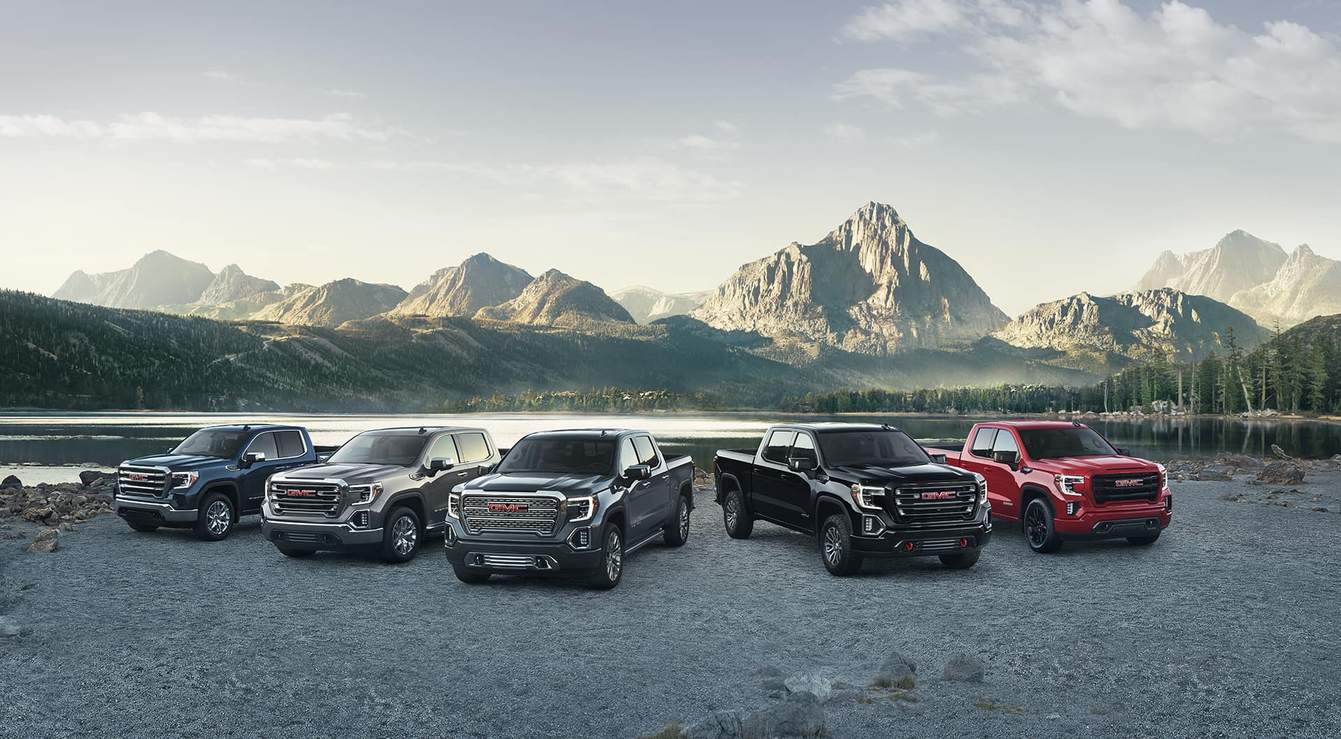 gmc sierra line up in front of mountians