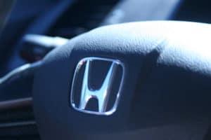 A sleek steering wheel highlights the Civic interior.