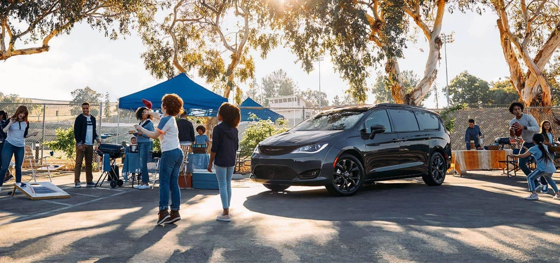 2020 Chrysler Pacifica in parking lot with tailgate party