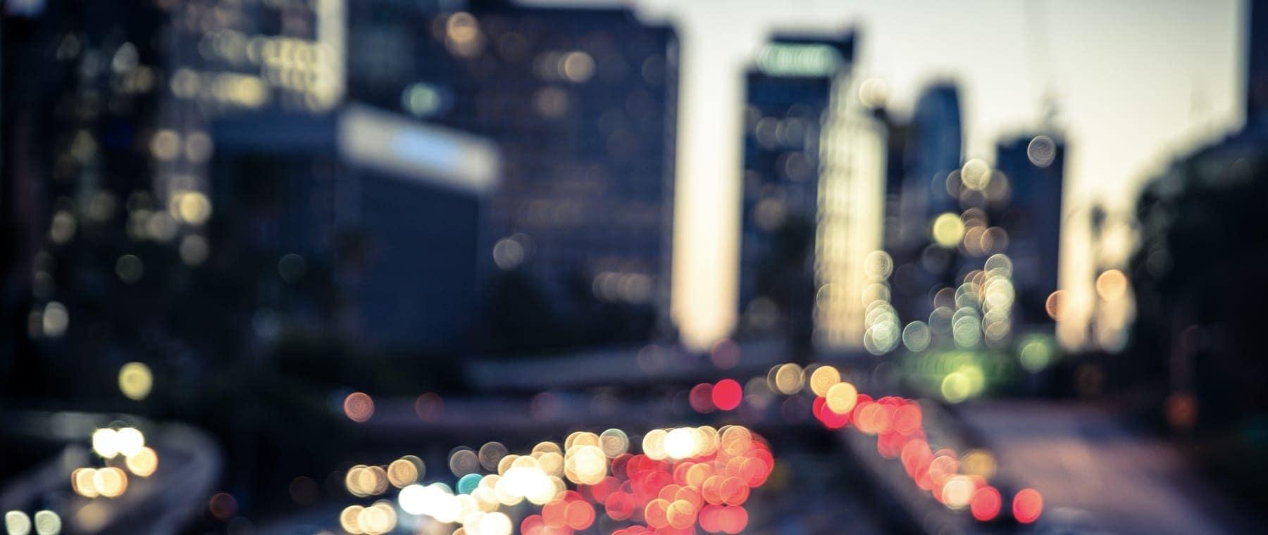 Blurry city street at dusk