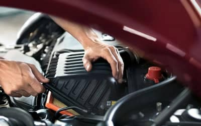 mechanic installs car battery