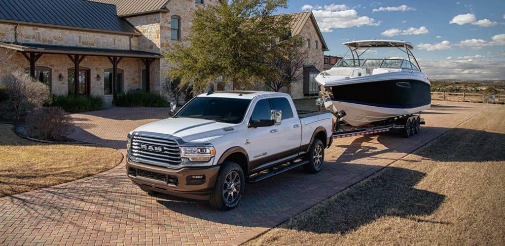 2021 RAM 2500 towing boat to the lake