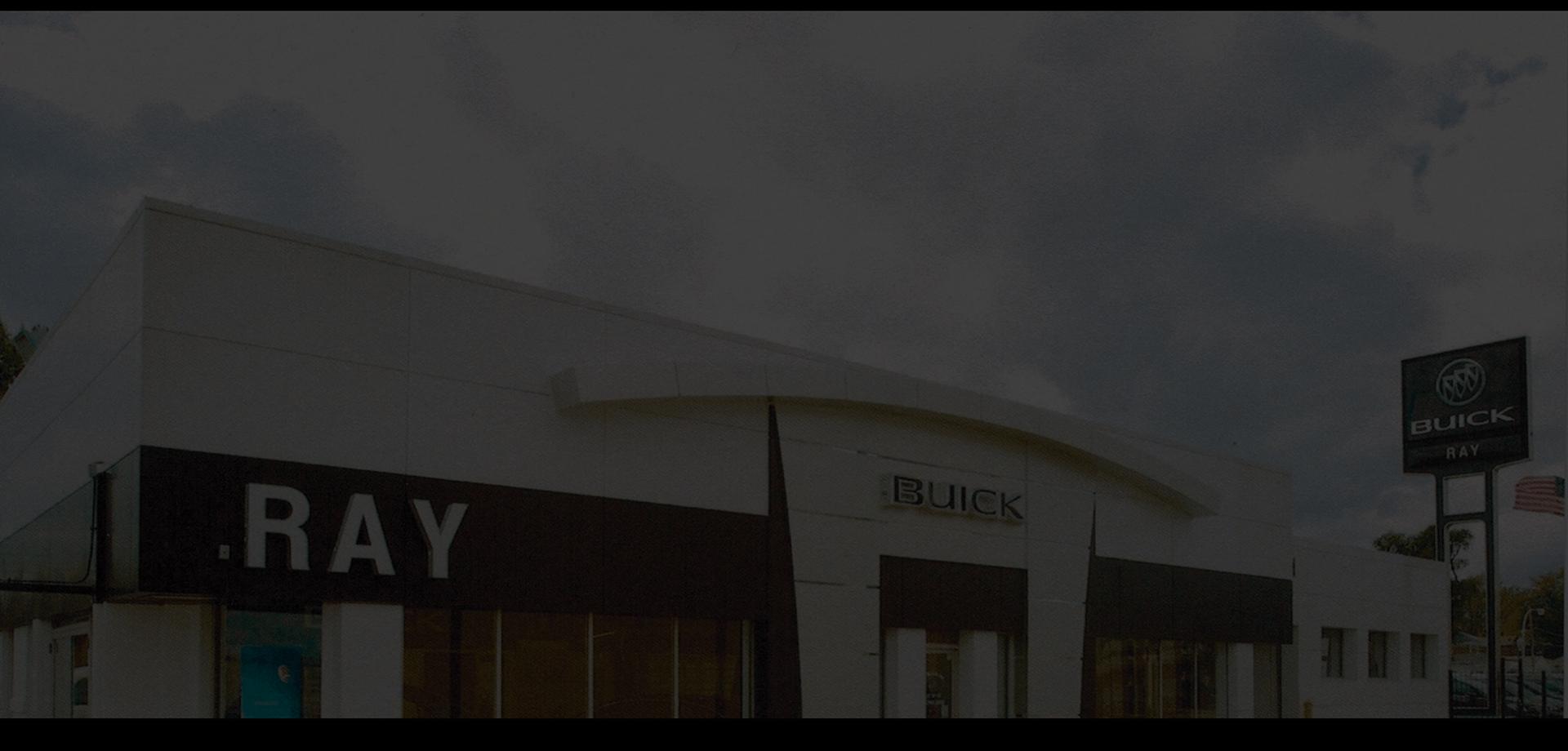 An exterior shot of a Buick GMC dealership building.