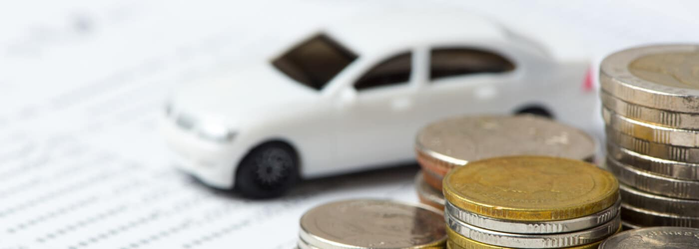 iny car with coins and finance paperwork